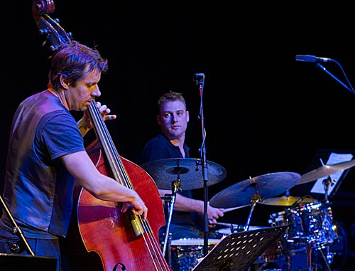 Phillip Rex on bass and Sam Bates on drums.