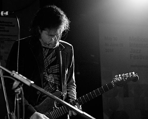 Jarmo Saari on electric guitar