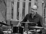 Darryn Farrugia on drums at Two Birds Brewery.